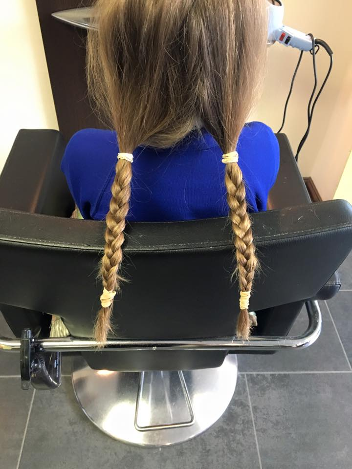 Image of childs hair before having it cut off for charity