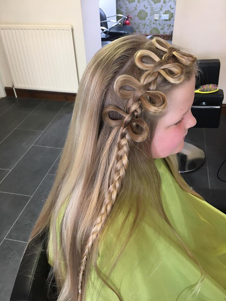 Young child with her hair done in a very stylish plait