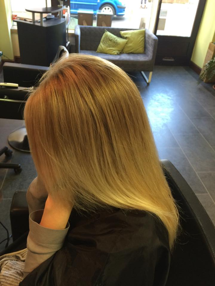 Image of a woman with long, blonde after having her hair cut