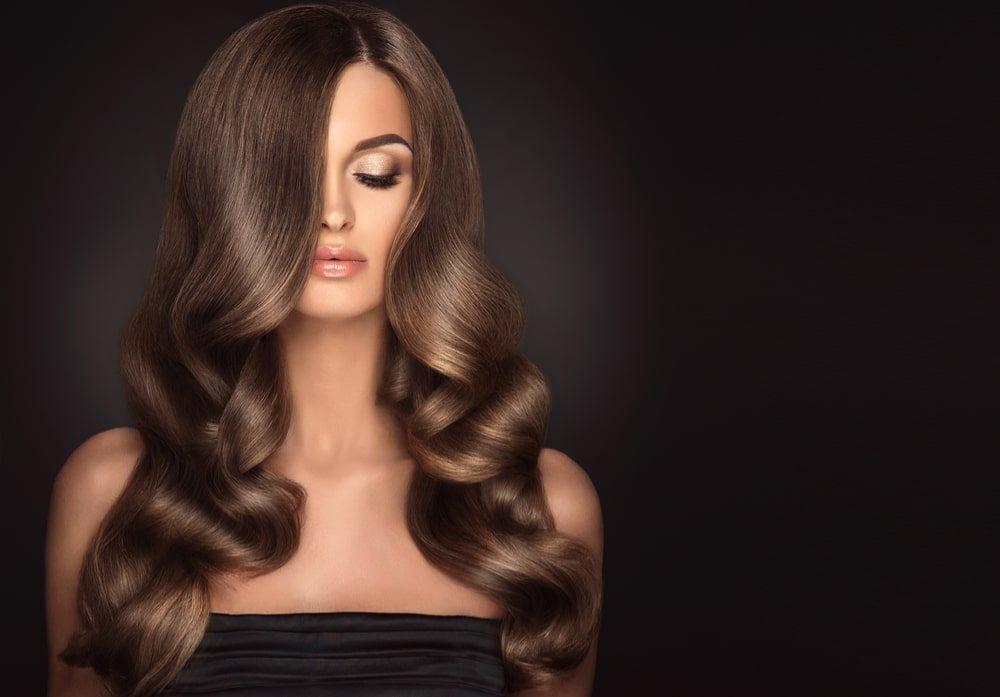 beautiful woman with long wavy haircut